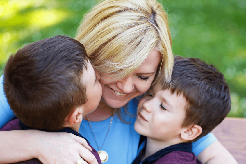 mother and two sons after winning child custody after legal separation