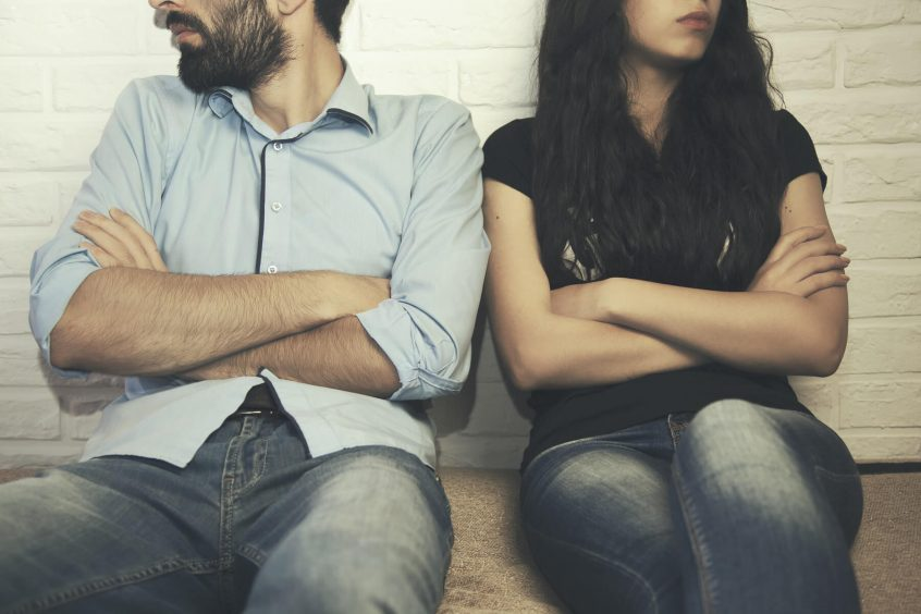 couple after verbal argument with arms crossed